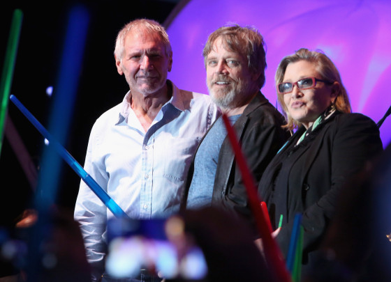 SAN DIEGO, CA - JULY 10:  (L-R) Actors Harrison Ford, Mark Hamill, Carrie Fisher and more than 6000 fans enjoyed a surprise `Star Wars` Fan Concert performed by the San Diego Symphony, featuring the classic