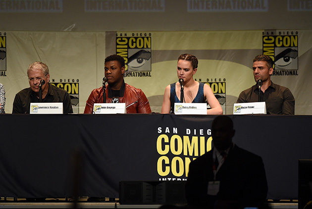 SAN DIEGO, CA - JULY 10:  (L-R) Screenwriter Lawrence Kasdan, actors John Boyega, Daisy Ridley, and Oscar Isaac speak onstage at the Lucasfilm panel during Comic-Con International 2015 at the San Diego Convention Center on July 10, 2015 in San Diego, California.  (Photo by Kevin Winter/Getty Images)