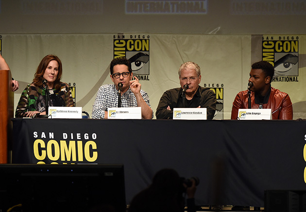 SAN DIEGO, CA - JULY 10:  (L-R) Producer Kathleen Kennedy, director J.J. Abrams, screenwriter Lawrence Kasdan, and actor John Boyega speak onstage at the Lucasfilm panel during Comic-Con International 2015 at the San Diego Convention Center on July 10, 2015 in San Diego, California.  (Photo by Kevin Winter/Getty Images)