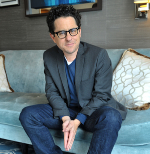 """FILE - In this May 4, 2013 file photo, JJ Abrams poses for a portrait session at the Corinthia Hotel in London. After resurrecting """"Star Trek,"""" Abrams has turned to another far away galaxy with """"Star Wars: The Force Awakens,"""" releasing in U.S. theaters on Dec. 18, 2015. Making it, he says, has been a constant conversation with himself as a wide-eyed boy, astonished by George Lucas' space opera. (Photo by Richard Chambury/Invision/AP, File)"""