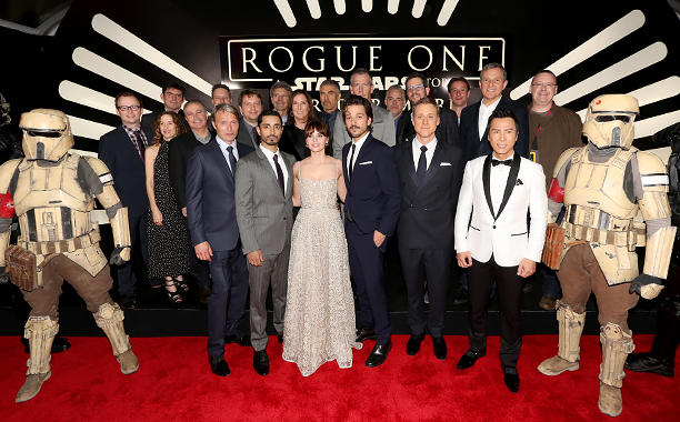 HOLLYWOOD, CA - DECEMBER 10:  (L-R front row)  Actors Mads Mikkelsen, Riz Ahmed, Felicity Jones, Diego Luna, Alan Tudyk and Donnie Yen (back row) Screenwriter Chris Weitz, director Gareth Edwards, Executive producer John Knoll, Producer Allison Shearmurs, Kathleen Kennedy, Chairman, The Walt Disney Studios, Alan Horn, actor Ben Mendelsohn, composer Michael Giacchino, producer Simon Emanuel and The Walt Disney Company Chairman and CEO Bob Iger attend The World Premiere of Lucasfilm's highly anticipated, first-ever, standalone Star Wars adventure,